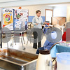 "Kyle Bursaw – kbursaw@shawmedia.com<br /> <br /> Lynn Fifer, a registered dietician at Kishwaukee Community Hospital, is seen through the kitchen window of the Genoa Township Park District building. Fifer was presenting a ""What's on Your Plate?"" lecture to seniors, explaining the government's recent changes to their nutrition guidelines in Genoa, Ill. on Tuesday, Jan. 17, 2012."