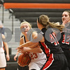 Rob Winner – rwinner@shawmedia.com<br /> <br /> DeKalb's Maddy Johnson (23) controls an offensive rebound in the third quarter during the Class 4A DeKalb Regional final on Thursday, Feb. 16, 2012. DeKalb defeated Huntley, 55-40.