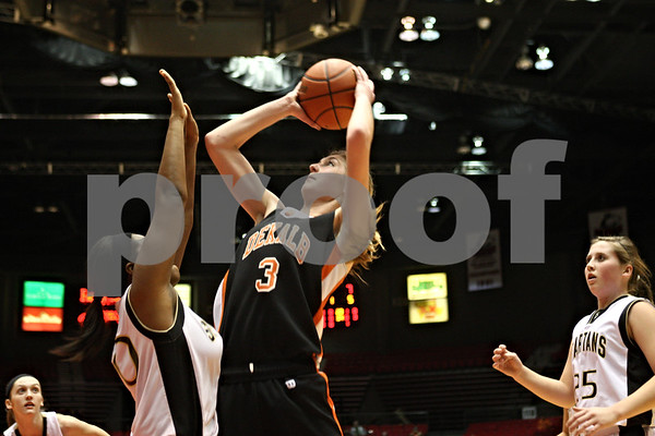 Rob Winner – rwinner@shawmedia.com<br /> <br /> Sycamore's Emerald Vaughn (left) tries to defend against DeKalb's Courtney Bemis during the first quarter. DeKalb defeated Sycamore, 39-37, on Friday night at the Convocation Center in DeKalb.