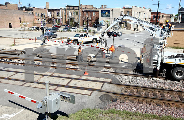 Kyle Bursaw – kbursaw@shawmedia.com<br /> <br /> Work is done at the railroad tracks on Second Street in in DeKalb, Ill. Both First and Second Streets had portions closed near the tracks.<br /> <br /> Taken Monday, April 9, 2012.