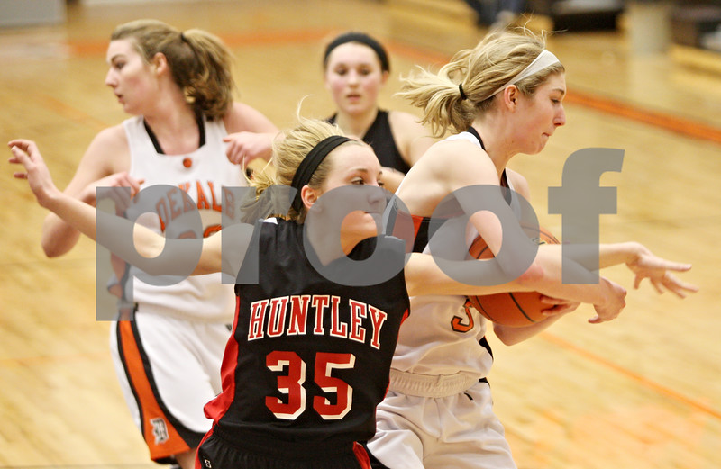 Rob Winner – rwinner@shawmedia.com<br /> <br /> Huntley's Abbey Shaw (35) and Courtney Bemis battle for possession in the third quarter during the Class 4A DeKalb Regional final on Thursday, Feb. 16, 2012. DeKalb defeated Huntley, 55-40.