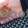 Kyle Bursaw – kbursaw@shawmedia.com<br /> <br /> Scott Joyner shows a coin he was awarded by Chief Jeff Stricklin for his service as a contract firefighter in Iraq.<br /> <br /> Pictured at Hopkins Park on Wednesday, April 11, 2012.