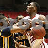 Rob Winner – rwinner@shawmedia.com<br /> <br /> Toledo guard Curtis Dennis (left) fouls Northern Illinois forward Keith Gray during the first half in DeKalb on Wednesday, Feb. 29, 2012.