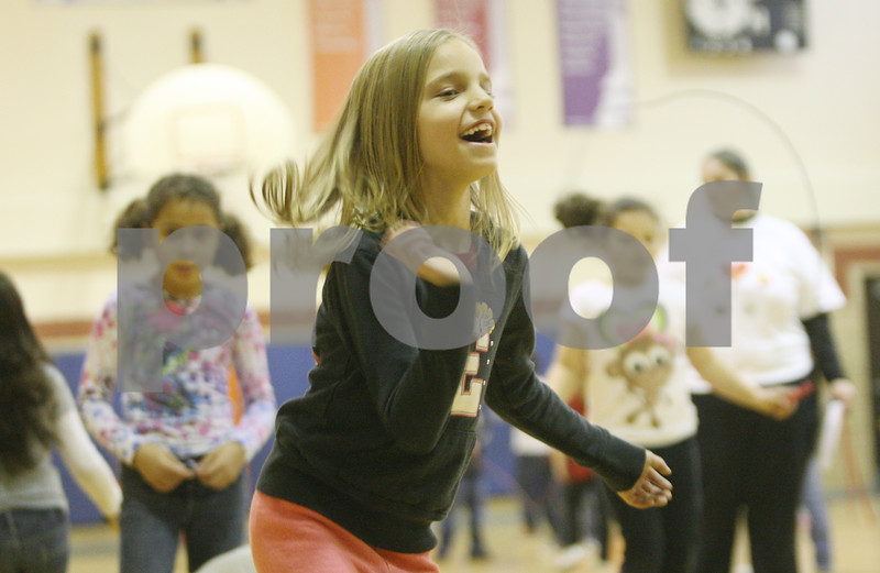 Rob Winner – rwinner@shawmedia.com<br /> <br /> McKenna Welch, 7, laughs while participating in the American Heart Association's Jump Rope for Heart fundraiser for those with heart problems on Wednesday afternoon at Kingston Elementary School.