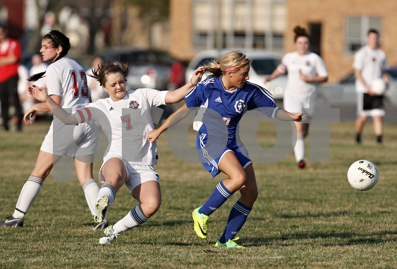 Rob Winner – rwinner@shawmedia.com<br /> <br /> Genoa-Kingston's Rachel Ellstrom (right) controls a ball ahead of Indian Creek's Samantha Meredith during the second half in Waterman on Thursday, March 15, 2012. G-K defeated Indian Creek, 2-1.