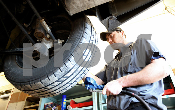 Kyle Bursaw – kbursaw@shawmedia.com<br /> <br /> Joe Moberg, a technician at Motor Works in DeKalb, checks the tire pressure on Chevy Impala, just one of several things inspected during an oil change on Wednesday, Jan. 4, 2012.