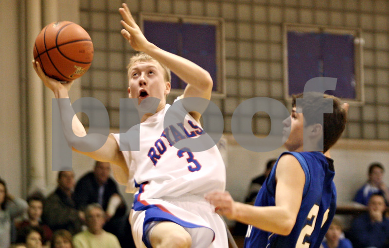 Rob Winner – rwinner@daily-chronicle.com<br /> <br /> Hinckley-Big Rock's Jared Madden (3) draws a foul from Westminster Christian defender Josh Beachler during the second quarter of the Class 1A Hinckley Regional championship game on Friday night.
