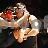 Rob Winner – rwinner@shawmedia.com<br /> <br /> Sycamore's Jesus Renteria (left) tries to free himself from the grasp of DeKalb's Doug Johnson during their 126-pound match in DeKalb on Thursday, Jan. 12, 2012.