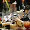 Chronicle File Photo<br /> <br /> DeKalb's Patrick Rourke (25) and Sycamore's Luke Johnson (11) leap for a loose ball during the second quarter of the game at the Northern Illinois University Convocation Center in DeKalb, Ill., on Friday Jan. 30, 2009.