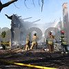 Kyle Bursaw – kbursaw@shawmedia.com<br /> <br /> Leland and Somonauk firefighters (from left) Jim Barnes, Fred Seville, Tim Nelson and Brad Cummings work to extinguish what's left of a building at 3159 Graham Rd in Somonauk, Ill. on Wednesday, March 28, 2012. Homeowner Michael Hamer said he has been grilling out about an hour before his meeting, and said that possibly is where the fire started.