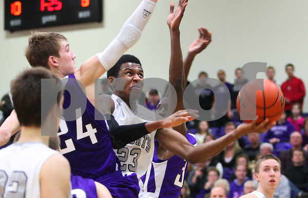 Kyle Bursaw – kbursaw@shawmedia.com<br /> <br /> Kaneland defeated Rochelle 65-61at Rochelle Township High School on Friday, March 2, 2012. The regional championship is the first for Kaneland under third-year coach Brian Johnson.