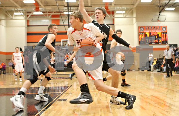 Rob Winner – rwinner@shawmedia.com<br /> <br /> DeKalb's James Robinson goes to the basket during the first quarter in DeKalb on Friday, Feb. 10, 2012. Kaneland defeated DeKalb, 65-55.