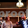 Kyle Bursaw – kbursaw@shawmedia.com<br /> <br /> Jack (at right, portrayed by Bill Gordon) tells a story to Valerie (Charlotte Fox) as Brendan (Ben Park) looks on from behind the bar during a rehearsal of 'The Weir' on Tuesday, Jan. 24, 2012.