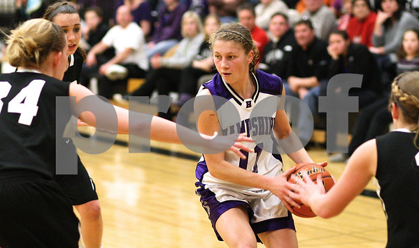 Kyle Bursaw – kbursaw@shawmedia.com<br /> <br /> Hampshire's Michelle Dumoulin looks to pass as Kaneland defenders move in during the second half of the game on Monday, Feb. 20, 2012. Kaneland defeated Hampshire 40-31.