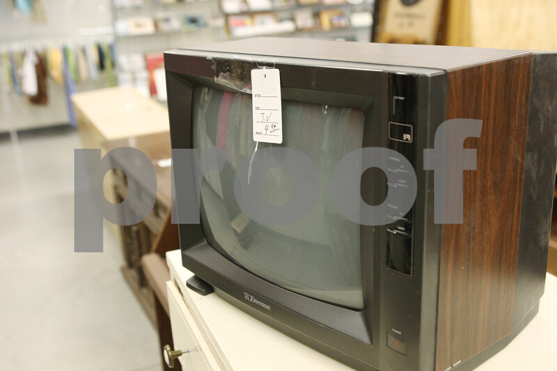 Rob Winner – rwinner@shawmedia.com<br /> <br /> A television priced at $4.99 sits atop a dresser at the Goodwill in DeKalb on Saturday morning. Recently Goodwill has received many unwanted televisions due to the state's new electronic waste law.