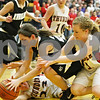 Rob Winner – rwinner@shawmedia.com<br /> <br /> Kaneland's Brooke Harner (left) and Belvidere North's Erinn Blake try to control a loose ball under the Knights' basket during the third quarter in a Class 3A Sycamore championship on Thursday, Feb. 23, 2012. Belvidere North defeated Kaneland, 43-31.