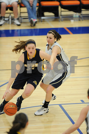 Kirl<br /> kland<br /> <br /> <br /> Kirkland Hiawatha's Rachel Stone (right) tries to stop the penetration of a Freeport Aquin player during the teams' matchup Monday in the Lanark Eastland 1A Sectional game. (Ryan Gaines)