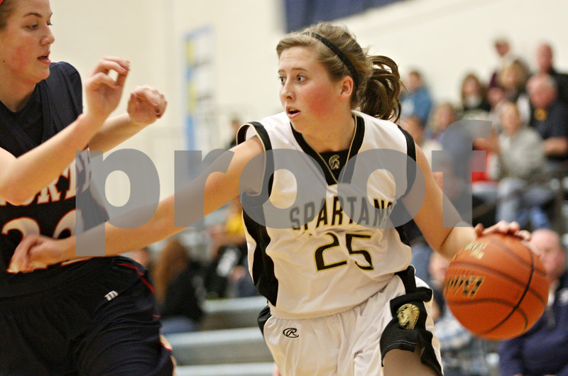 Rob Winner – rwinner@shawmedia.com<br /> <br /> Belvidere North guard Anna Martensen (left) pressures Sycamore's Bailey Gilbert during the first quarter of the Central High School Thanksgiving Tournament championship game in Burlington on Wednesday, Nov. 23, 2011.
