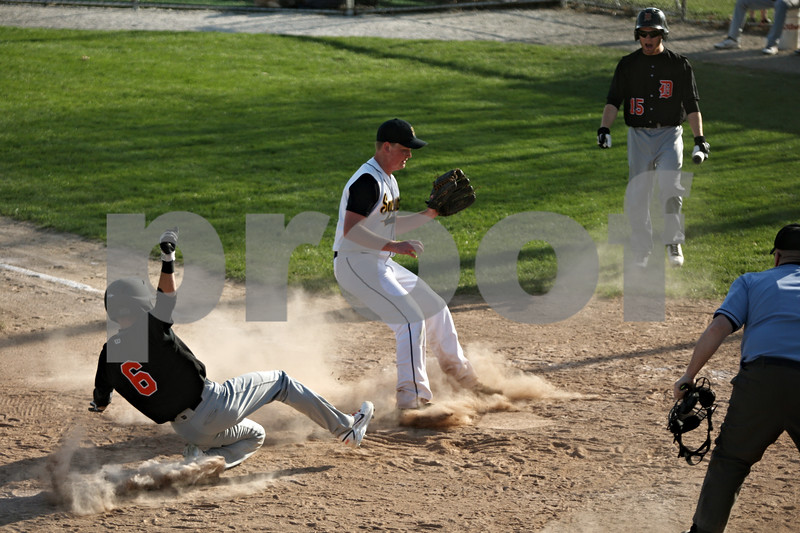 Rob Winner – rwinner@shawmedia.com<br /> <br /> DeKalb baserunner Kevin Sullivan (6) scores on a passed ball thrown by Sycamore pitcher Will Olson during the top of the third inning Thursday in Sycamore. DeKalb defeated Sycamore, 9-2.