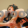 Rob Winner – rwinner@shawmedia.com<br /> <br /> DeKalb's Jackson Montgomery (right) competes against Prospect's Sam Lobono during their 106-pound match at the Don Flavin Tournament on Friday, Dec. 30, 2011, in DeKalb, Ill.