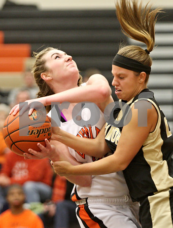 Rob Winner – rwinner@shawmedia.com<br /> <br /> DeKalb's Emily Bemis (left) and Sycamore's After a steal Sycamore's Ashley Leclair struggle for possession of a ball under the Barbs' basket during the third quarter in DeKalb on Thursday, Feb. 9, 2012.