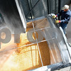 Kyle Bursaw – kbursaw@shawmedia.com<br /> <br /> Mark Neff, a long-time employee on Tracy Jones' farm, keeps an eye on the corn level in a truck as it fills up on Tuesday, March 27, 2012.