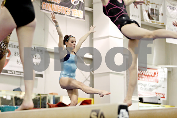 Rob Winner – rwinner@shawmedia.com<br /> <br /> DeKalb gymnast Alyssa Lopez works out on the balance beam during practice at Energym in Sycamore, Ill. on Monday, Jan. 2, 2012.