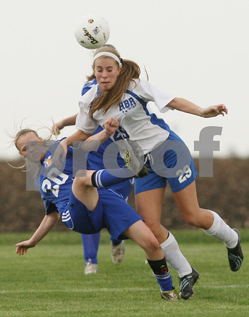 Rob Winner – rwinner@shawmedia.com<br /> <br /> Aurora Central Catholic's Lisa Gaffino (left) and Hinckley-Big Rock's Josie Kossman collide during the first half in Hinckley on Thursday. H-BR defeated ACC, 2-0.