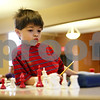 Rob Winner – rwinner@shawmedia.com<br /> <br /> 6-year-old Kelebrant Hays, of Aurora, looks over at the timer while participating in a year-end DeKalb Chess Club tournament at the First Congregational Church in DeKalb on Saturday, Dec. 31, 2011.