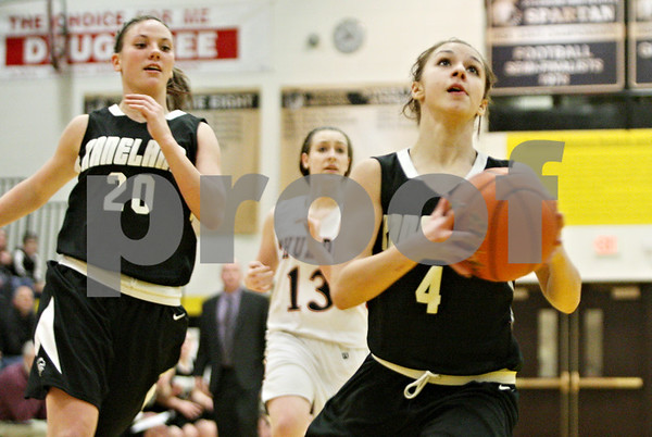Rob Winner – rwinner@shawmedia.com<br /> <br /> Kaneland's Alli Liss (4) puts up two with a layup during the first quarter in a Class 3A Sycamore championship on Thursday, Feb. 23, 2012.
