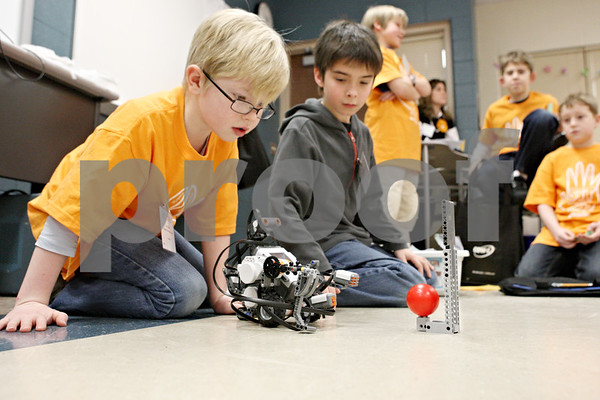 Rob Winner – rwinner@shawmedia.com<br /> <br /> Founders Elementary School students Iain Skaret (left), 8, and Nick Glover, 9, watch their robot that they helped create with Legos as it conducts a task during a presentation at the Students Involved with Technology Conference on Saturday afternoon at DeKalb High School. SIT is a conference presented by school districts that provide a forum where kids in grades three to twelve can demonstrate technology tools they have learned in school or that they are interested in.<br /> <br /> Iain Skaret and Nick Glover (sp)<br /> DeKalb, Ill.<br /> Saturday, Feb. 18, 2012