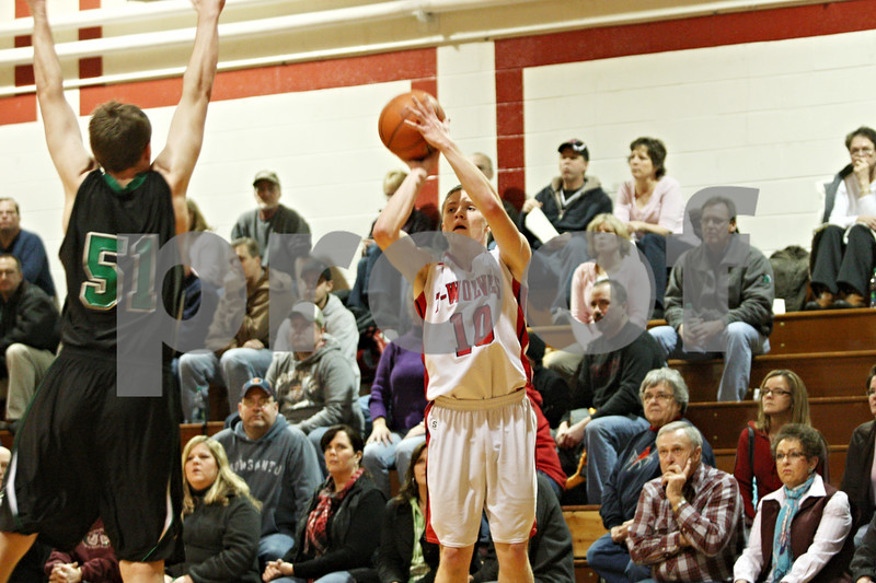 Rob Winner – rwinner@shawmedia.com<br /> <br /> Indian Creek's Jaron Todd puts up a field goal during a the first half of a game against North Boone in Shabbona on Tuesday, Jan. 24, 2012.