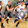 Kyle Bursaw – kbursaw@shawmedia.com<br /> <br /> Indian Creek players Tyler Reynolds (left) and Jacob Bjorneby chase after Hinckley-Big Rock's Bernie Conley as he makes his way to the basket in the third quarter of the Little Ten Conference Tournament semifinal game at Somonauk High School on Thursday, Feb. 2, 2012.