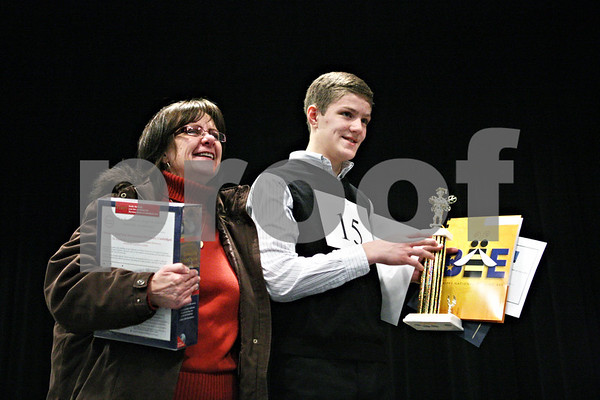 "Rob Winner – rwinner@shawmedia.com<br /> <br /> Carole Rydecki (left) stands on stage with her son Ben Rydecki, 14 of Somonauk Middle School, after Ben won the DeKalb County Spelling Bee at Kishwaukee College on Saturday, Feb. 25, 2012. ""Oratorio"" was the winning word of the spelling bee which lasted 14 rounds."