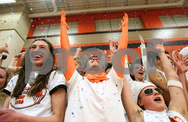 Kyle Bursaw – kbursaw@shawmedia.com<br /> <br /> DeKalb students including (from left) Jessica Schafer, Evan Jones and Matt Hoyle rain confetti just before the start of their final home basketball game against Sycamore. DeKalb defeated Sycamore 41-36 at DeKalb High School on Friday, Feb. 24, 2012.