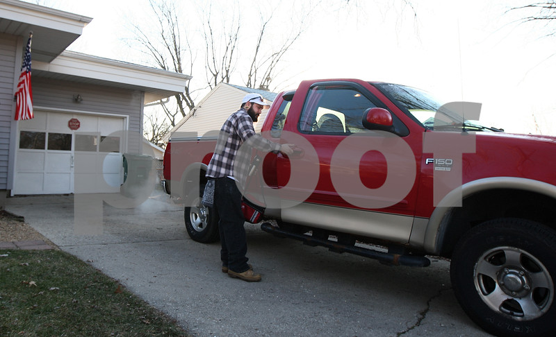 Kyle Bursaw – kbursaw@shawmedia.com<br /> <br /> Chris Brundies, Jordan's boss, picks Matt Jordan up from his parents' house before the two head into work on Friday, Dec. 16, 2011. Jordan lost his driver's license several years ago and also does not have a car.