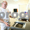 Kyle Bursaw – kbursaw@shawmedia.com<br /> <br /> Dave Weaver of Sycamore looks on as the counting machine takes his ballot during the primary election on Tuesday, March 20, 2012.