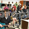 "Kyle Bursaw – kbursaw@shawmedia.com<br /> <br /> Jacob Kvasnicka plays guitar along with the rest of the DeKalb High School Jazz Ensemble in the band room on Monday, March 12, 2012. The group will be competing in the 17th annual ""Essentially Ellington"" competition."