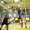 Rob Winner – rwinner@shawmedia.com<br /> <br /> Kaneland's Marcel Neil puts up a shot over Rockford East's Steven McNease in the second quarter of a Class 3A Sycamore Sectional semifinal on Tuesday, March 6, 2012.