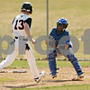 Rob Winner – rwinner@shawmedia.com<br /> <br /> Woodstock catcher Eric Bell (right) tags out DeKalb base runner Nick Bourdages (13) who attempted to score after a pop fly in the bottom of the fourth inning in DeKalb on Saturday, March 17, 2012.