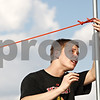 Rob Winner – rwinner@shawmedia.com<br /> <br /> Hinckley-Big Rock's Billy Weissinger adjusts the height of the high jump during track practice in Big Rock on Friday afternoon.