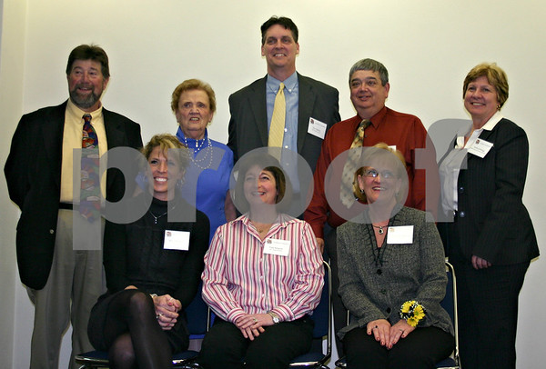 Five people were given presented with Excellence in Education Awards Monday. Pictured from top left are Gil Morrison, Yvonne Johnson, award recipient Tim Carlson, award recipient Daniel Mitchell and Anita Zurbrugg. From the left on bottom are award recipients Elizabeth Ness, Fran Kenyon and Stephanie Forsberg.<br /> <br /> By Nicole Weskerna - nweskerna@shawmedia.com