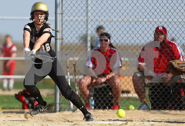 Kyle Bursaw – kbursaw@shawmedia.com<br /> <br /> Sycamore's Tristyn Criswell bunts during the game against Ottawa at Sycamore Park on Monday, March 19, 2012. Ottawa defeated Sycamore 2-1.