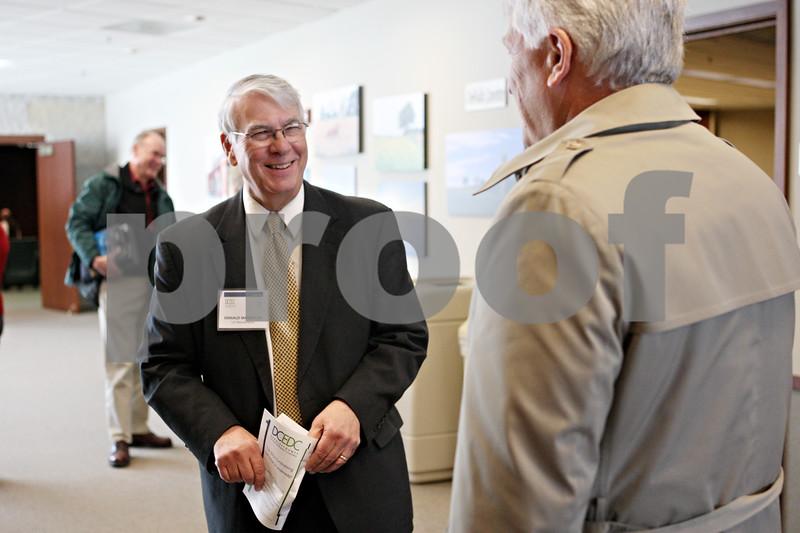 Rob Winner – rwinner@shawmedia.com<br /> <br /> Don Manzullo (left), who is running for the 16th Congressional Seat in Illinois, speaks with DeKalb County Farm Bureau president Paul Rasmussen, Jr., after the DeKalb County Economic Development Corporation luncheon on Monday, Jan. 30, in DeKalb.<br /> <br /> DeKalb, Ill.<br /> Monday, Jan. 30, 2012
