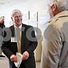 Rob Winner – rwinner@shawmedia.com<br /> <br /> Don Manzullo (left), who is running for the 16th Congressional Seat in Illinois, speaks with DeKalb County Farm Bureau president Paul Rasmussen, Jr., after the DeKalb County Economic Development Corporation luncheon on Monday, Jan. 30, in DeKalb.<br /> <br /> DeKalb, Ill.<br /> Monday, Jan. 30, 2012