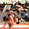Kyle Bursaw – kbursaw@shawmedia.com<br /> <br /> DeKalb's Doug Johnson brings Sycamore's Colton Burns down to the mat in their 126-pound semifinal match at the IHSA DeKalb AA Regional on Saturday, Feb. 4, 2012.