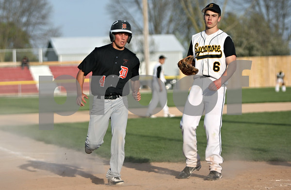 Rob Winner – rwinner@shawmedia.com<br /> <br /> DeKalb baserunner Patrick Aves (4) scores on a passed ball thrown by Sycamore pitcher Alex Keller (6) during the top of the sixth inning Thursday in Sycamore. DeKalb defeated Sycamore, 9-2.