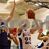Rob Winner – rwinner@shawmedia.com<br /> <br /> Hinckley-Big Rock's Lauren Paver (22) looks to shoot over Serena's Jeri Brennan (24) in the first quarter during their Little Ten Conference tournament game in Earlville on Thursday.