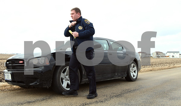 Kyle Bursaw – kbursaw@shawmedia.com<br /> <br /> Kirkland police officer Tim McWilliams goes to bring a warning to a driver for not stopping at a stop sign in Kirkland, Ill. on Tuesday, Feb. 21, 2012. McWilliams told Sgt. Paul Lindstrom (in the car) that the woman was complaining about being stopped. A few minutes later Kirkland police also received call from the woman's husband about the warning.