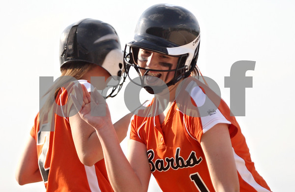 Rob Winner – rwinner@shawmedia.com<br /> <br /> DeKalb pinch runner Samantha Volk (left) high fives Katie Kowalski after Kowalski drove in a run during the bottom of the second inning in DeKalb on Wednesday.